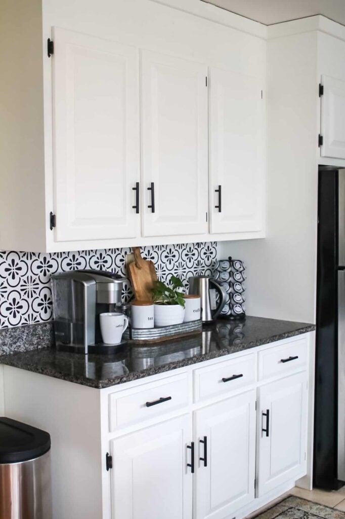 white cabinets/black handles
