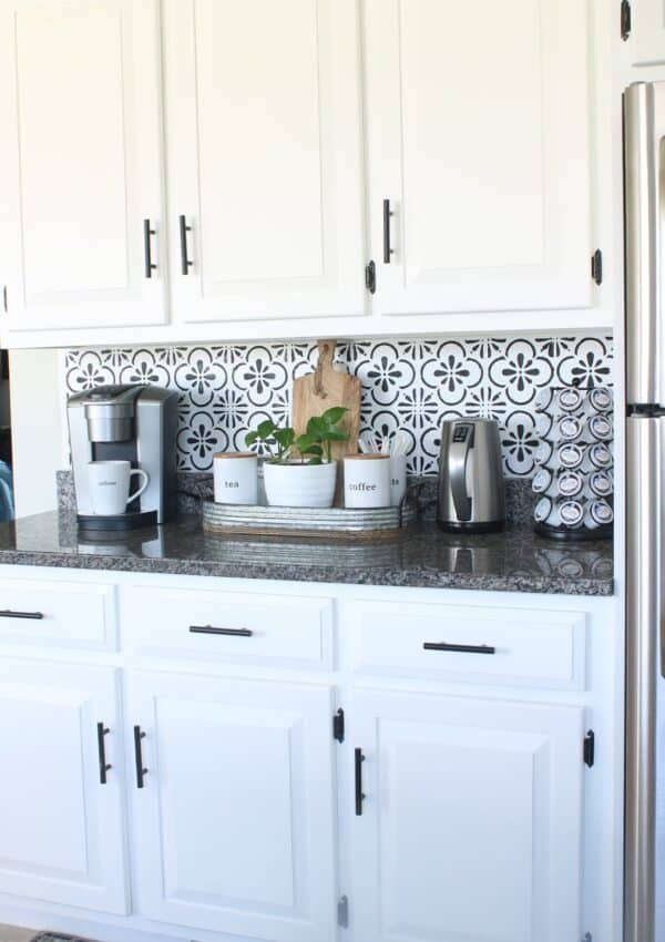 white kitchen cabinets w/ black handles