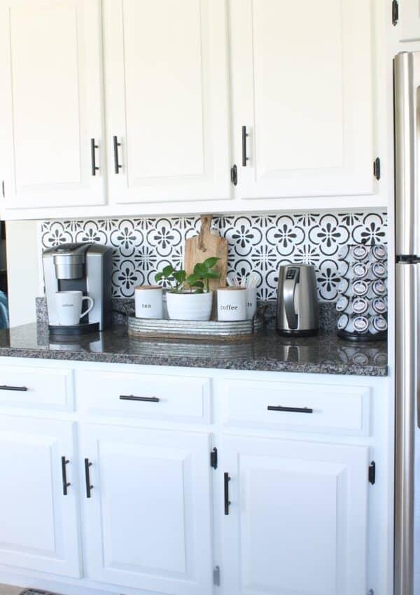white kitchen cabinets w/ black handles