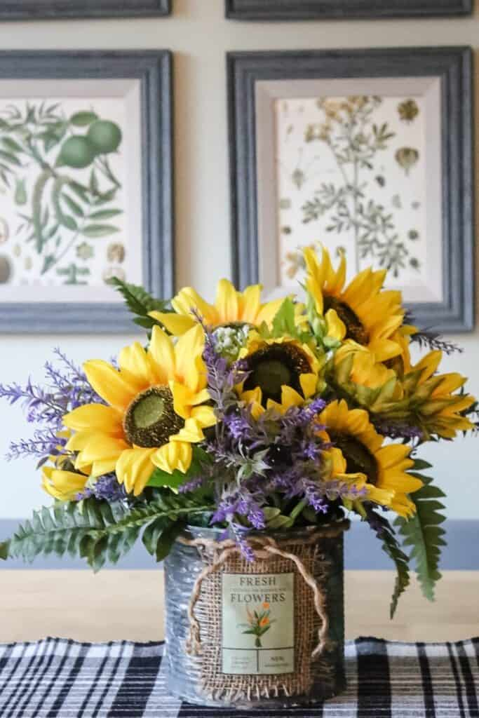 SUNFLOWER ARRANGEMENT IN RUSTY CONTAINER