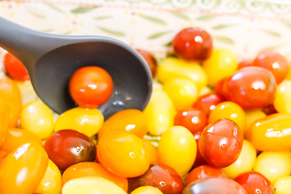 tossing tomatoes in olive oil