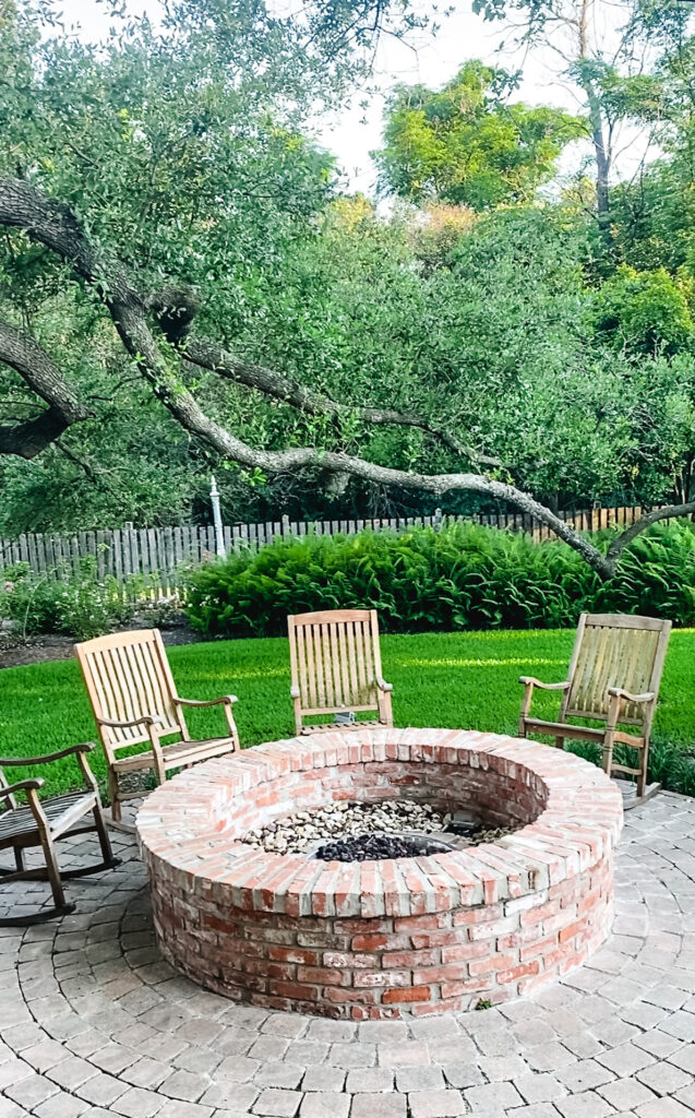 brick fire pit with wood chairs